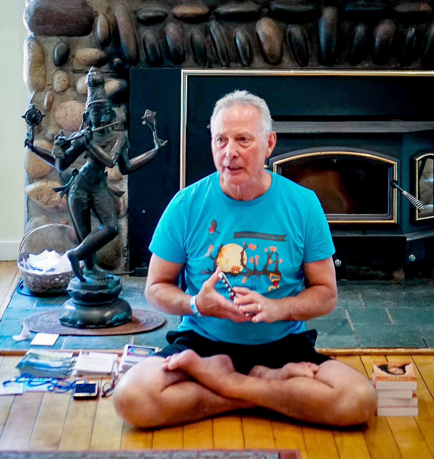 Roy Thibodeau, a longtime member of the Song of the Morning community, leads a meditation program in the Lodge during YogaFest 2017.