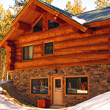 Custom log home with massive 20+ Inch logs