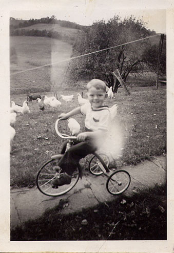 Clarence Neltner as a small boy riding his bike circa 1940's. That concrete path still exists today.