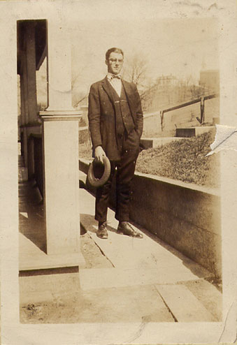 Lawrence Neltner as a young man in circa 1920's. Over his shoulder you'll notice St Joes Camp Springs church. Lawrence grew up and lived on the Farm all his life.