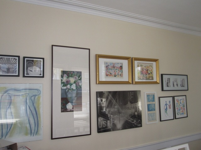 Here is a photo of the art wall in one of Sofia's apartments.