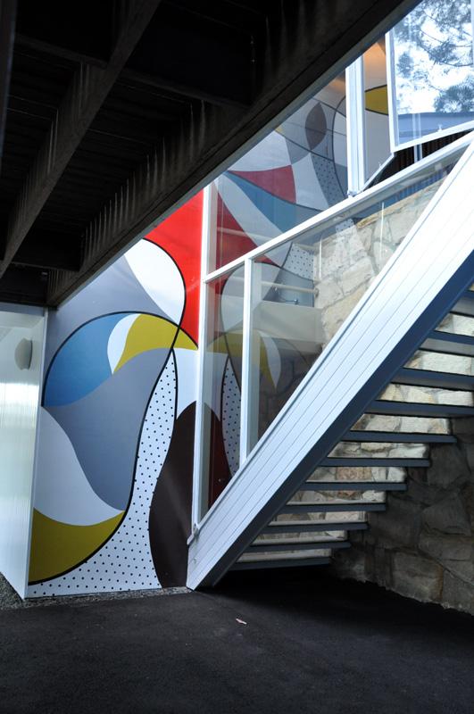 Mural extends to main floor garage area