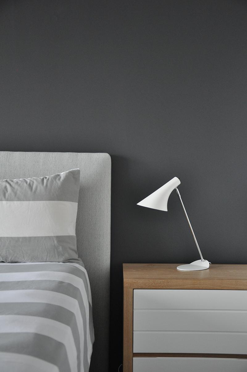 Custom covered headboard in the master bedroom.