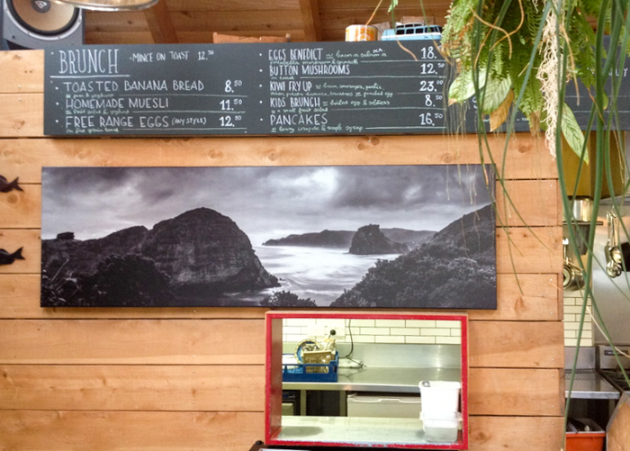 A perfect example of the right use of canvas in a high traffic area,the award winning    Piha Storm   at 1600mm wide in the Piha Cafe
