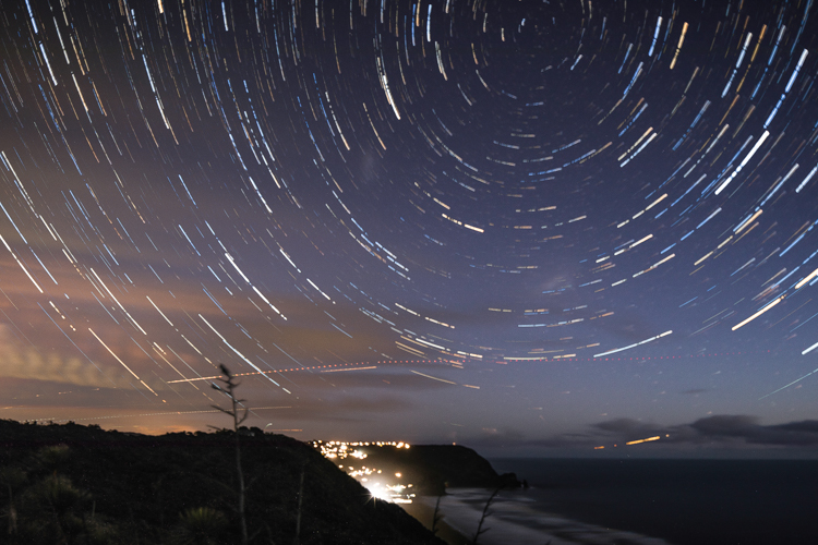Piha from Anawhata road... 106 frames, each 30 seconds long, stacked. The horizontal light lines are planes leaving Auckland airport.