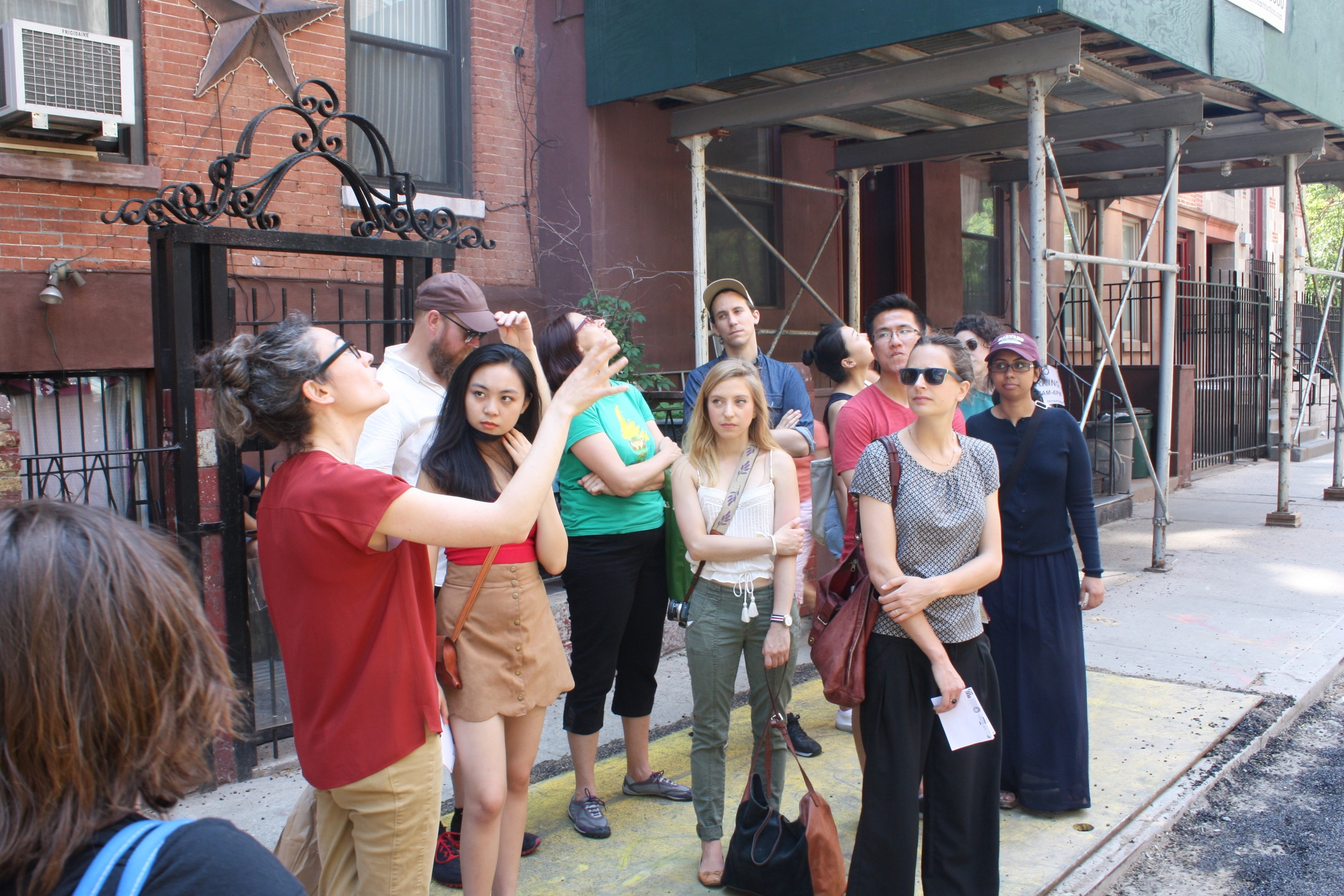 In front of the old PS 64 during the walk in the East Village.