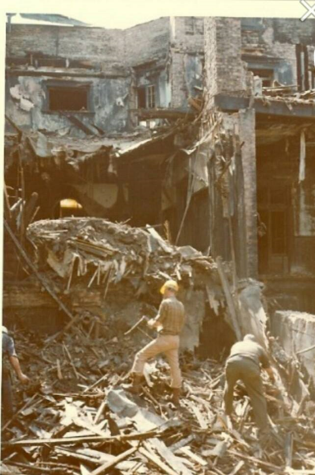 The Mansion after the fire. The men are actually standing in the basement.