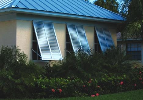 70 Blue Bahama Adjustable Arms Hidden Behind shutters