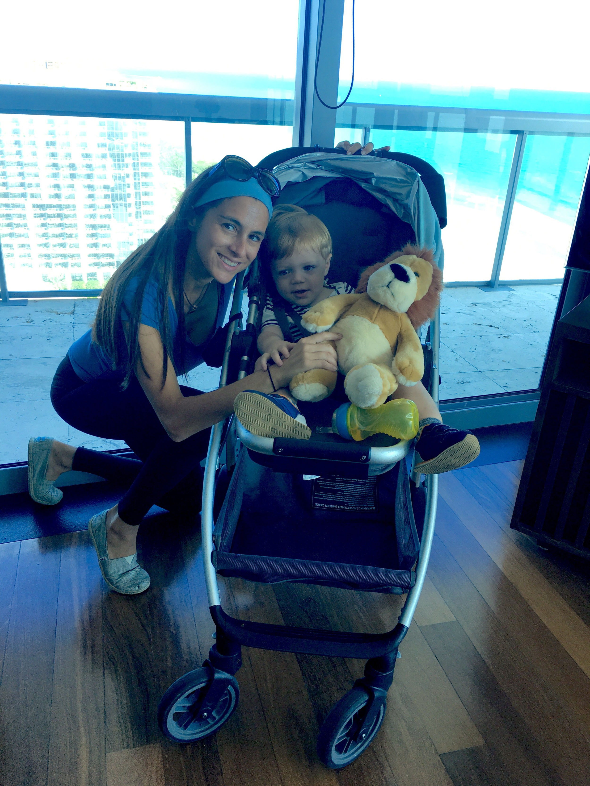 Robbie and I in an Oceanfront Two Bedroom Suite with The Setai's Lion, a signature kid amenity.