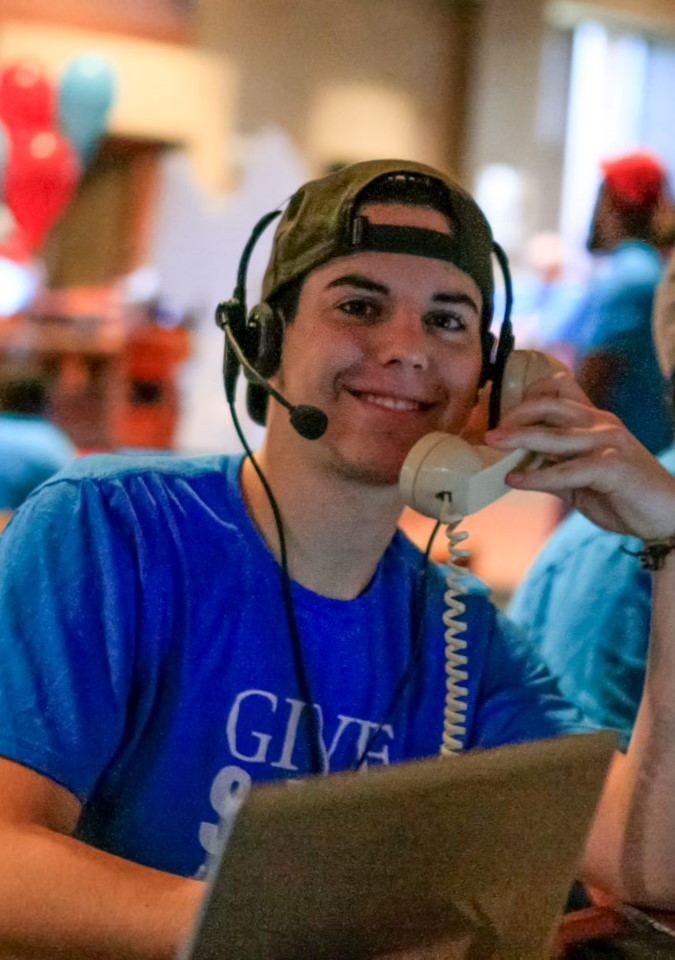 Kyle Busta '19, an environmental studies major from New Prague, Minnesota, makes calls on Give SJU Day.