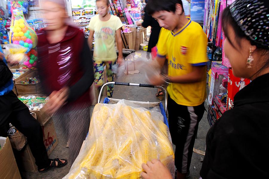 A food cart selling corn is pulled through Dordoy Bazaar in Bishkek, Kyrgyzstan. photo:  @jentsetgo