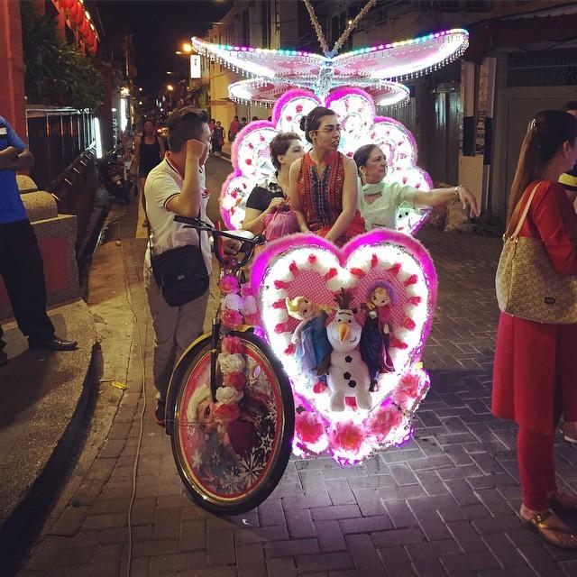Women in a trishaw in Malacca, Malaysia