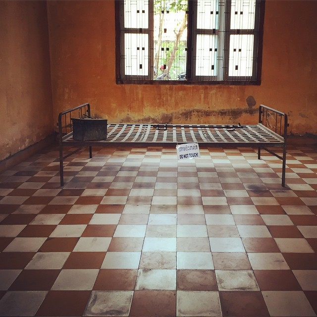 """Bed where a prisoner (in this case a """"VIP"""", a member of the former ruling party) lay shackled to the bed, tortured until finally executed at the Tuol Sleng Museum, Phnom Penh, Cambodia"""