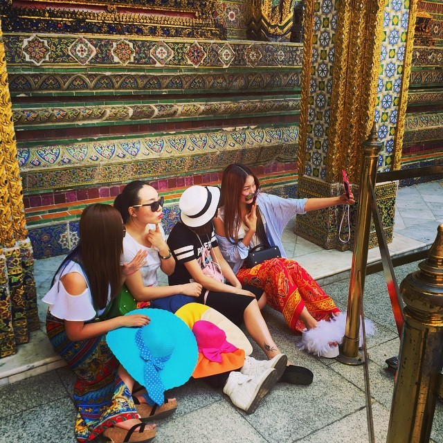 All the world's a photo shoot: selfie-ing at the Grand Palace in Bangkok, Thailand