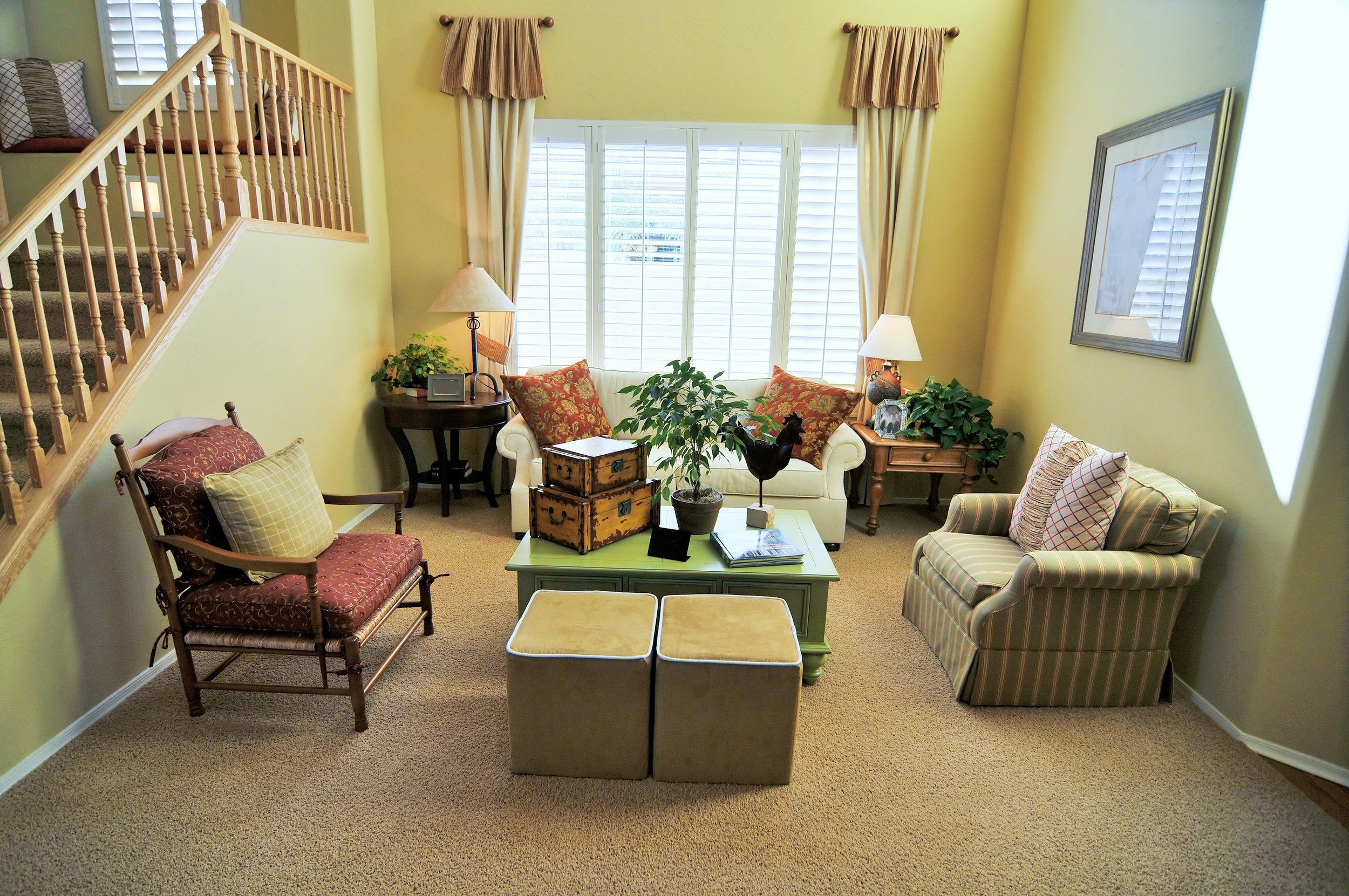 Living room with large window shutters