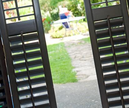 Wooden patio door shutters