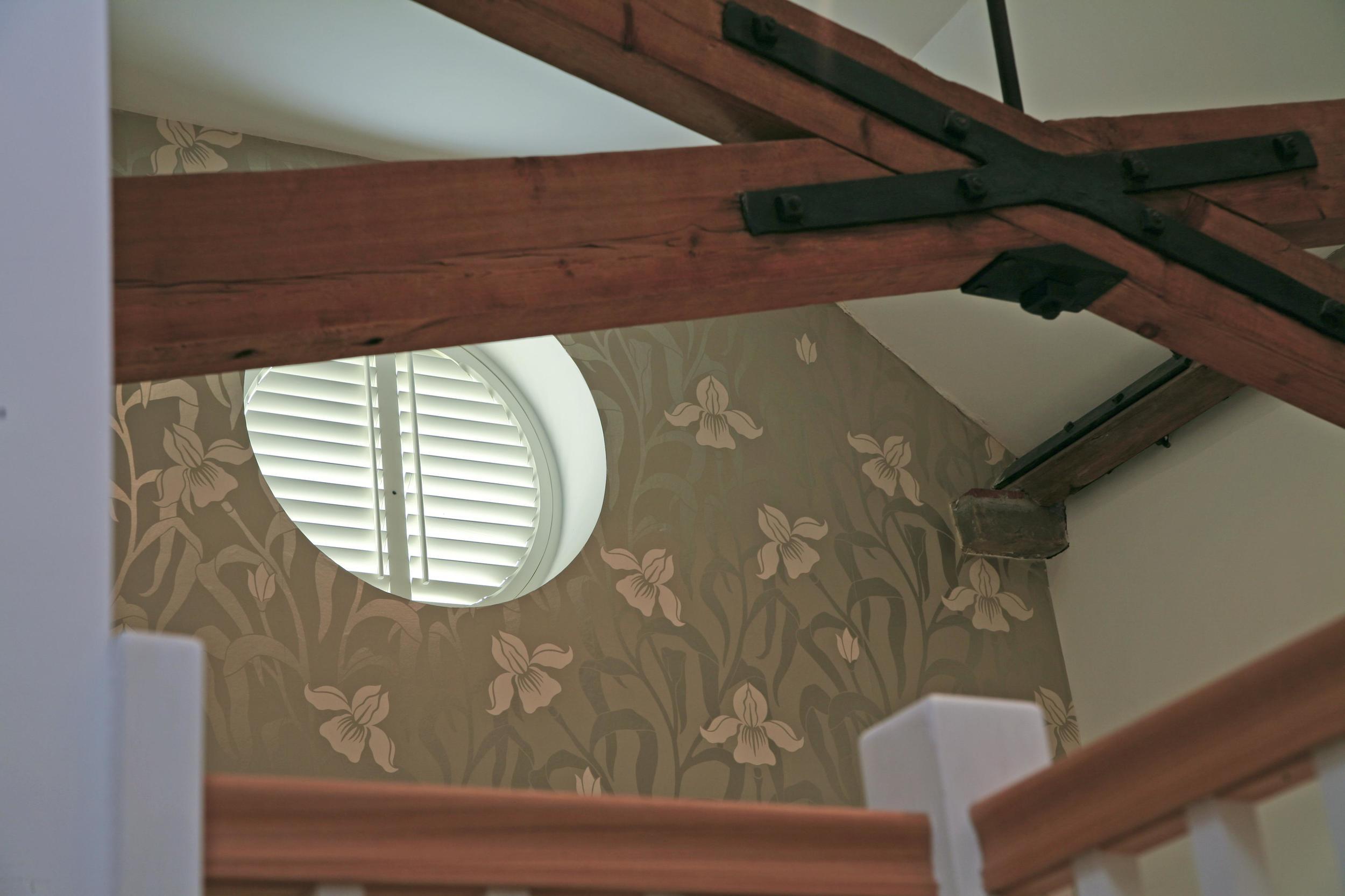 Wooden shutter on small window