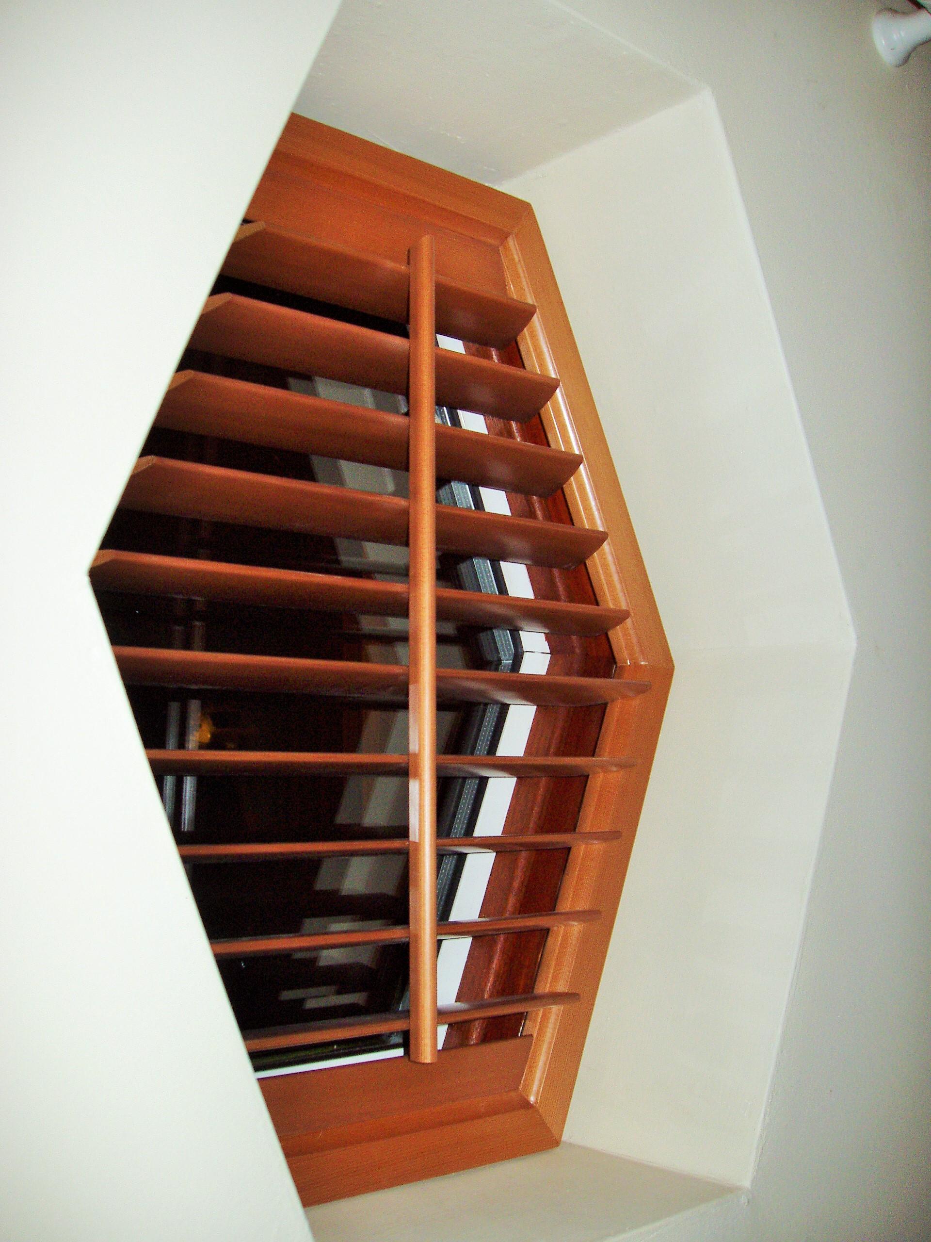 Wooden hexagonal shutter on special shape window