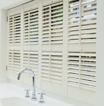 White wooden and mdf shutters kitchen