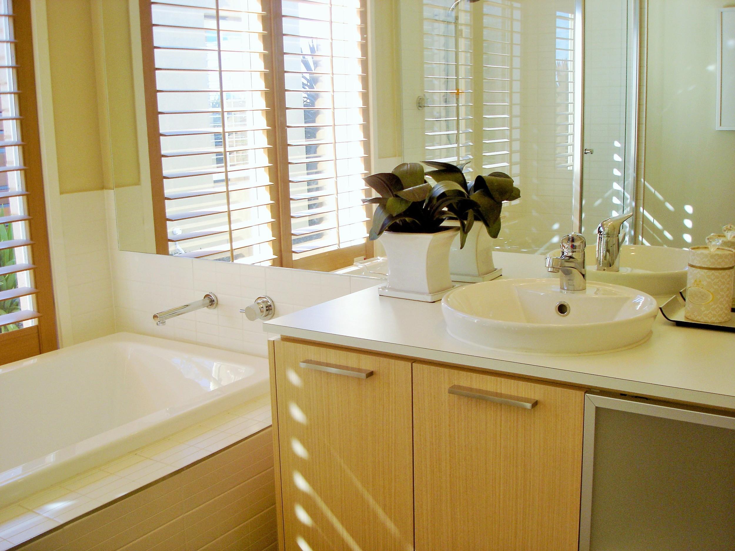 bathroom-window-dressing-shutters.jpg