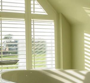 shutters-for-bathroom-window-adds-privacy.jpg
