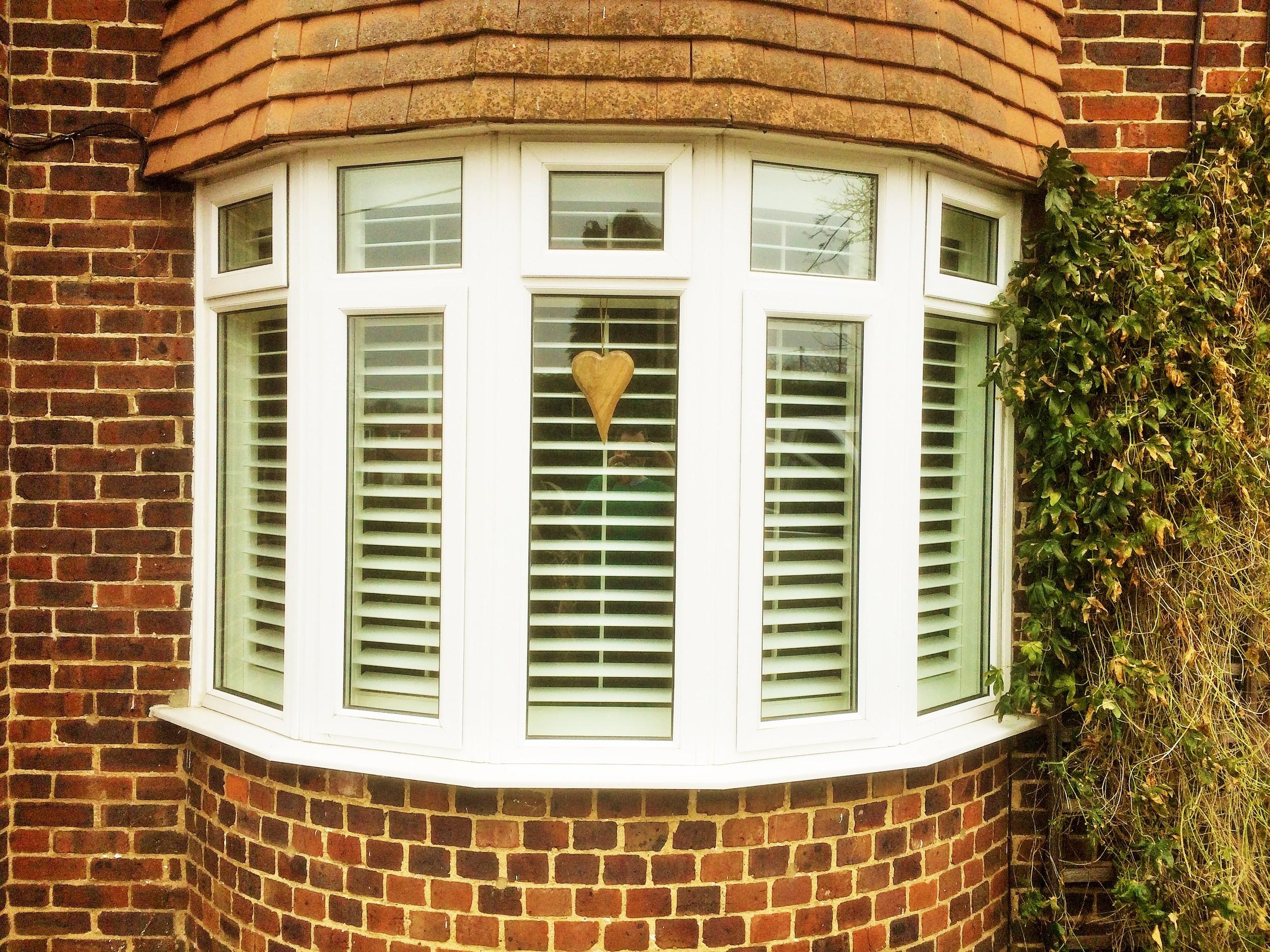 view-from-street-bow-window-with-plantation-shutters-ashvale-aldershot-£873.JPG