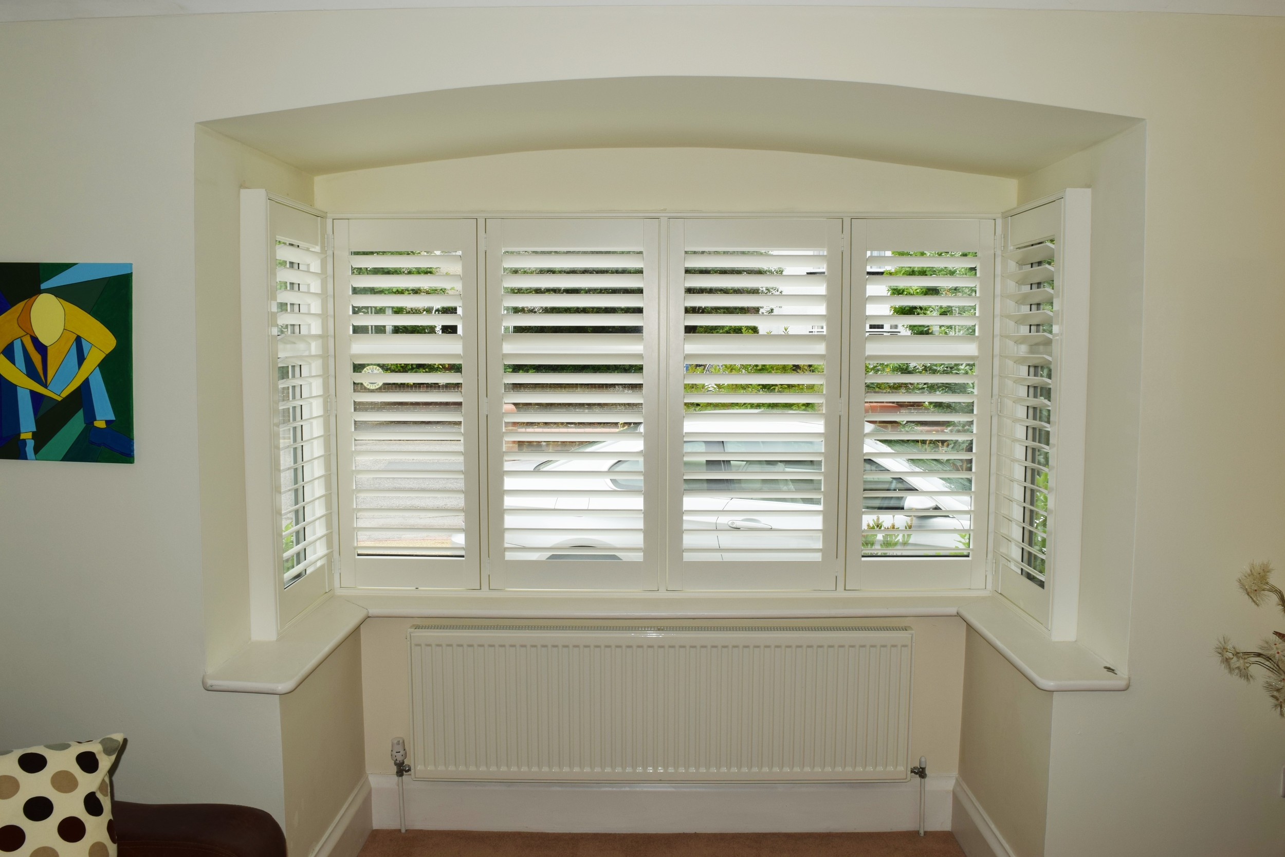 Bay window coverings plantation shutters