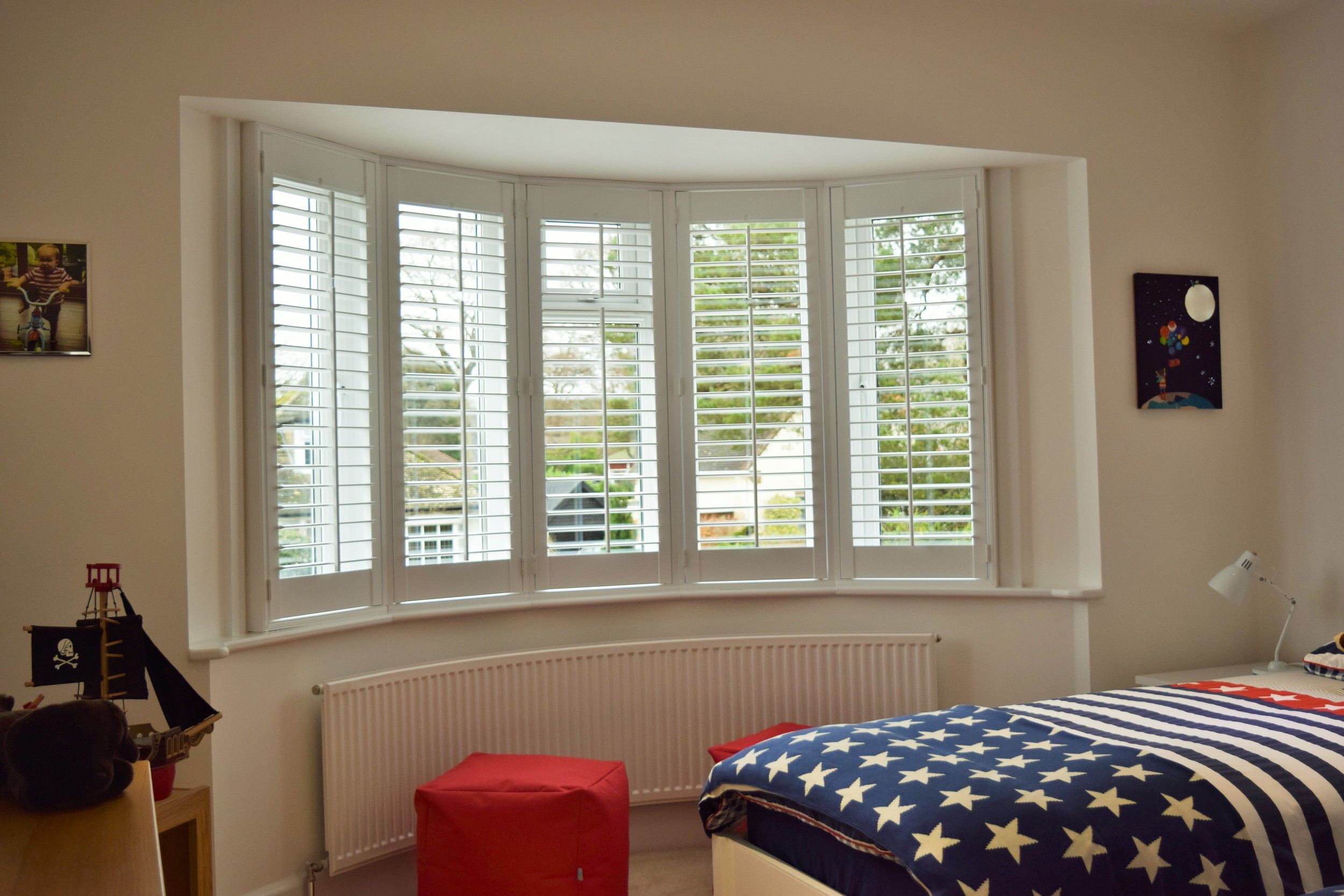 Ideas for window covering in boys room plantation shutters
