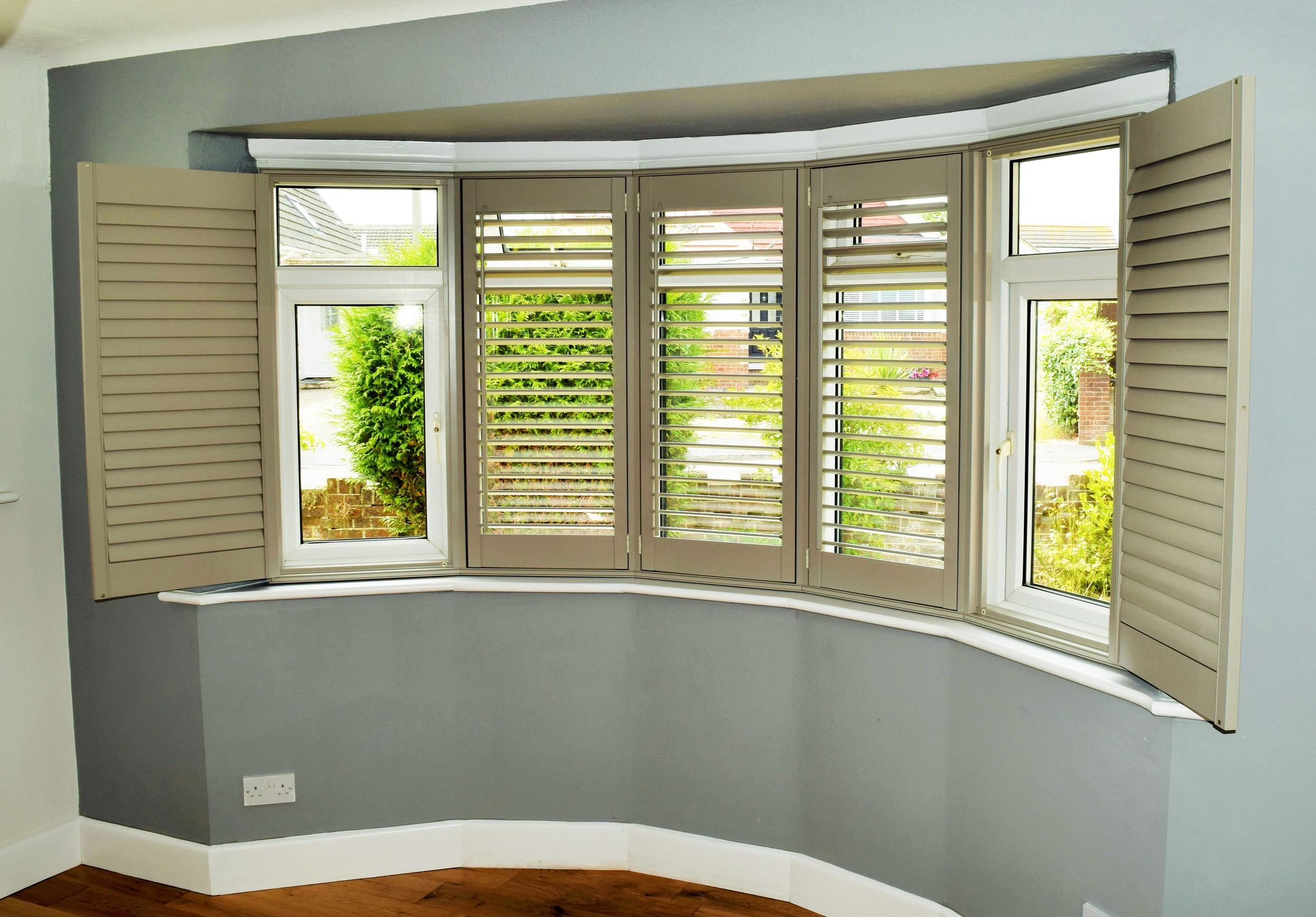 Bay window wooden shutters.JPG