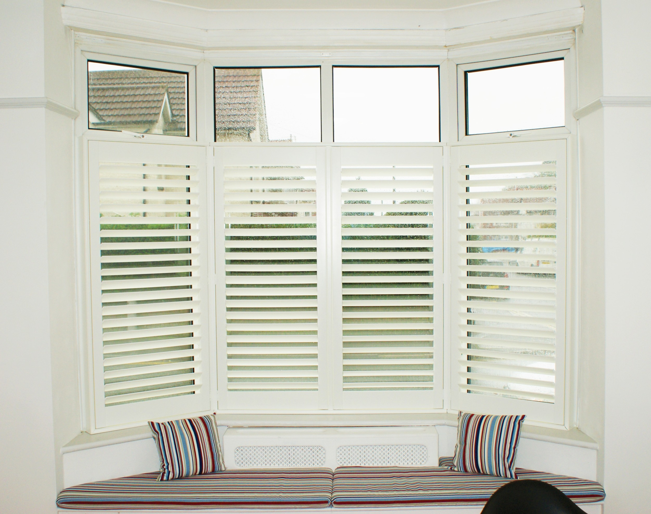 Plantation shutters window seat
