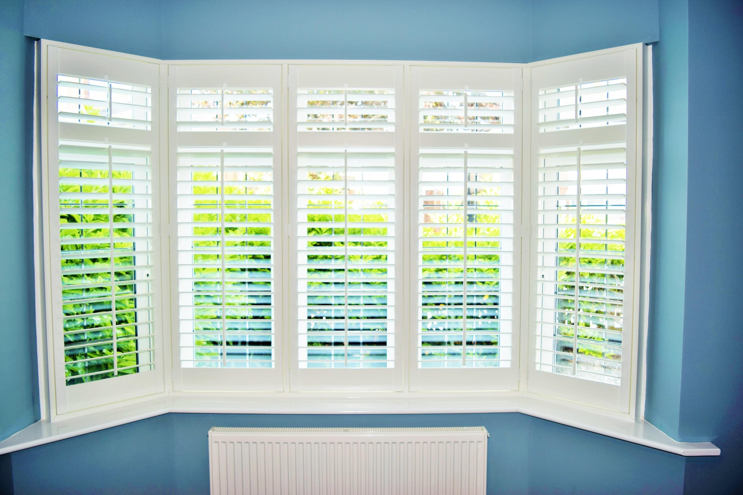 Bay window interior plantation shutters Bournemouth.JPG