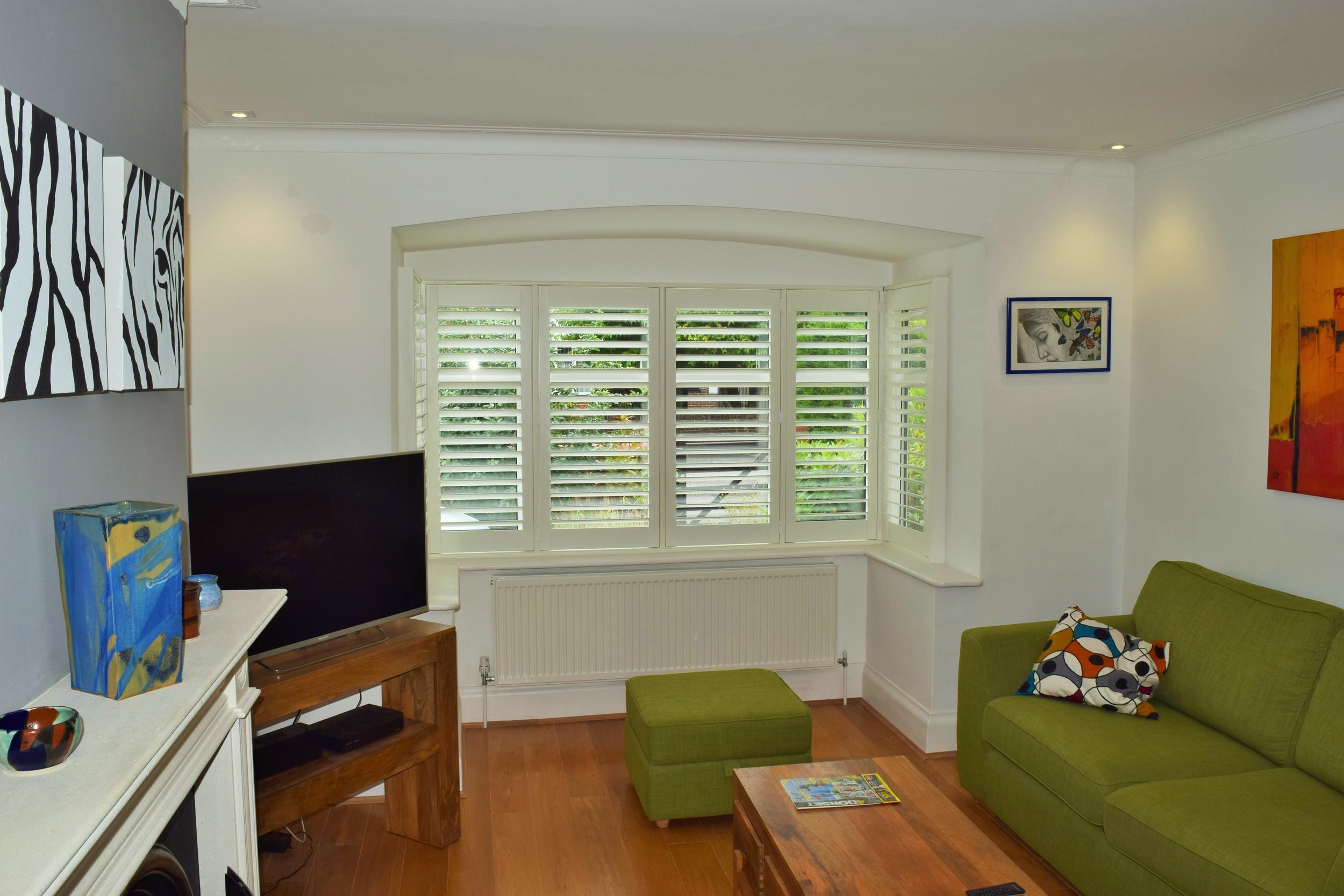 Interior wooden shutters living room Poole.JPG