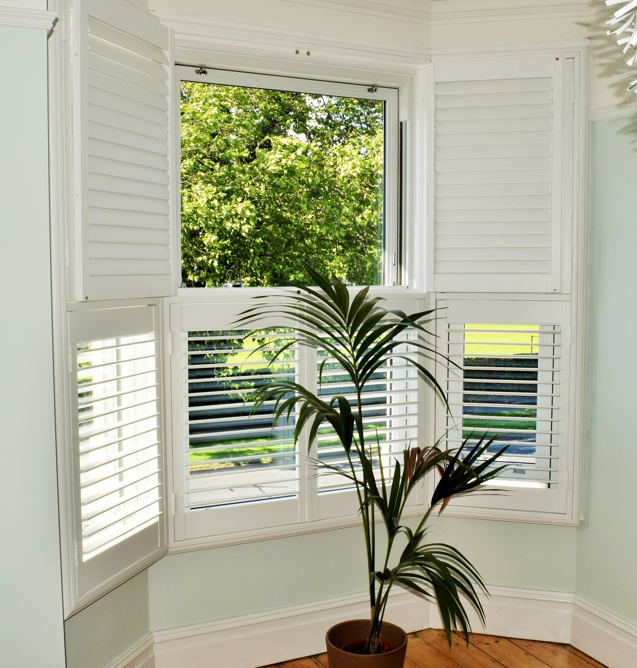 Tier on tier bay window wooden shutters Portsmouth Hampshire