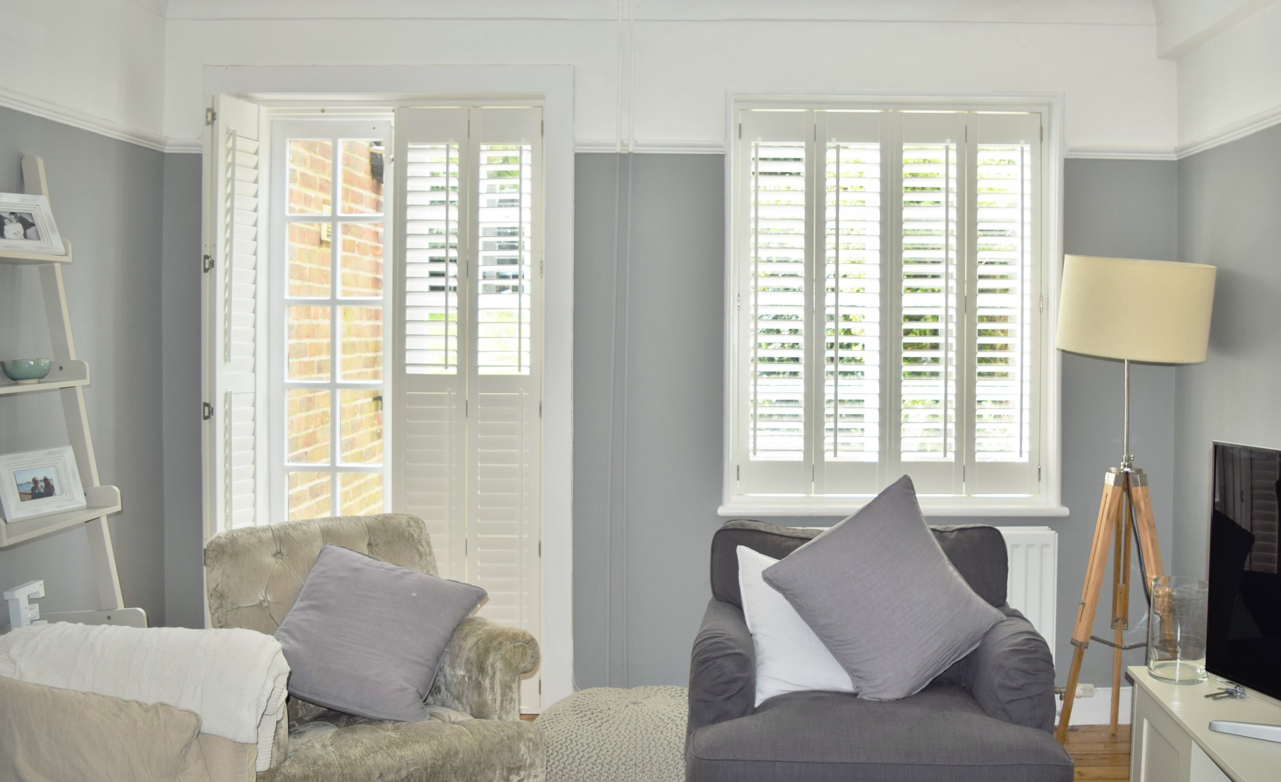 White wooden shutters on patio doors