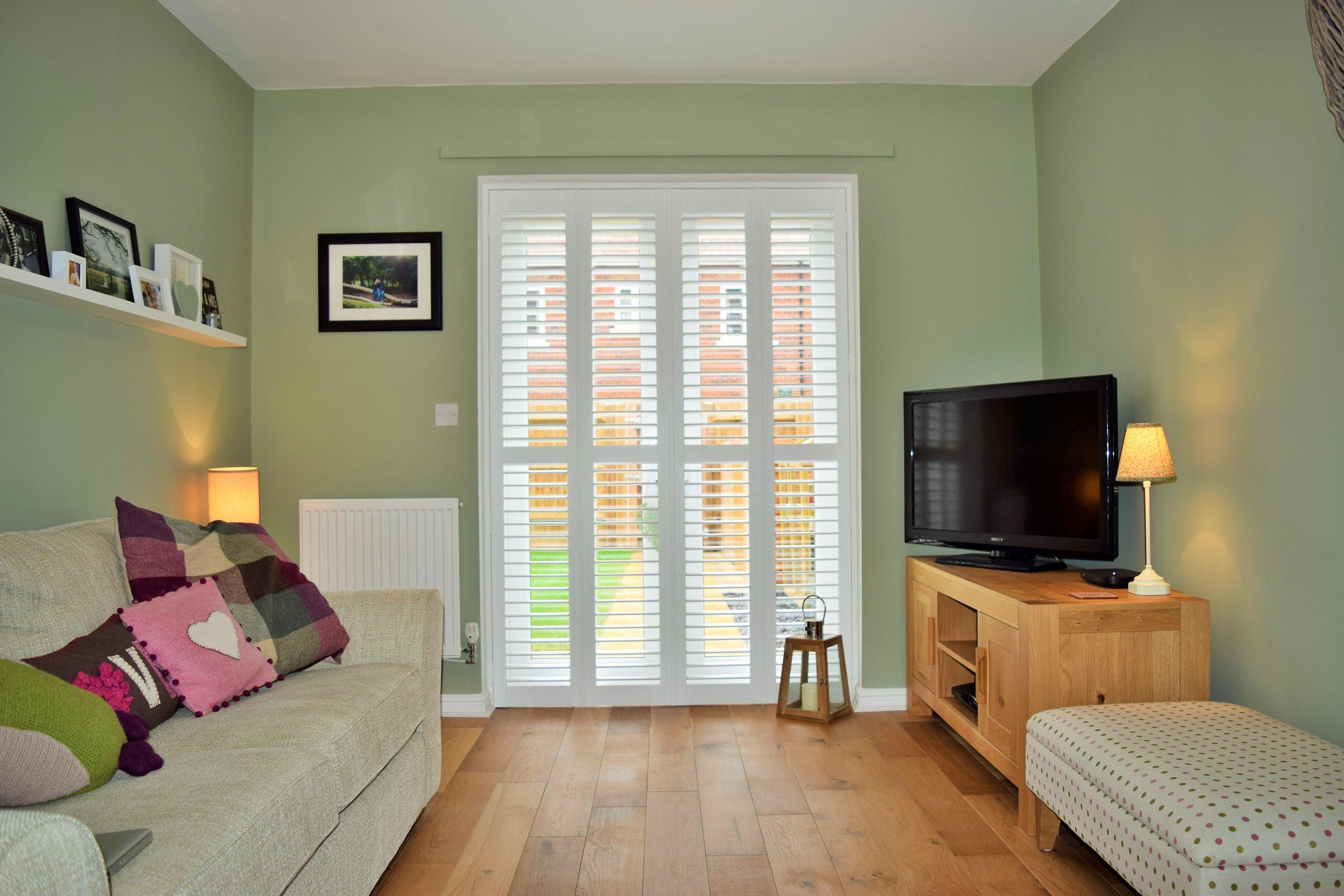 Living room patio door shutters