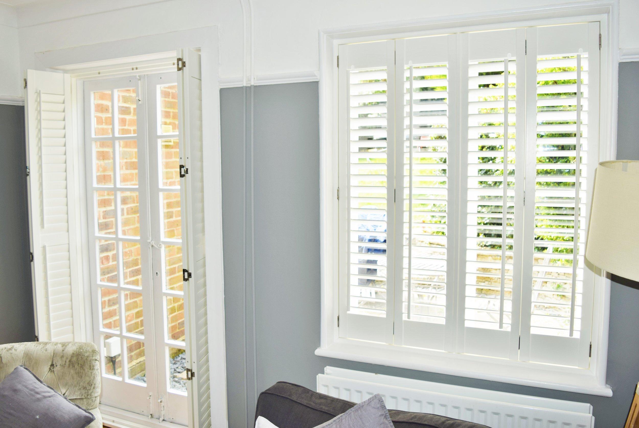 Open patio door shutters with silver hinges