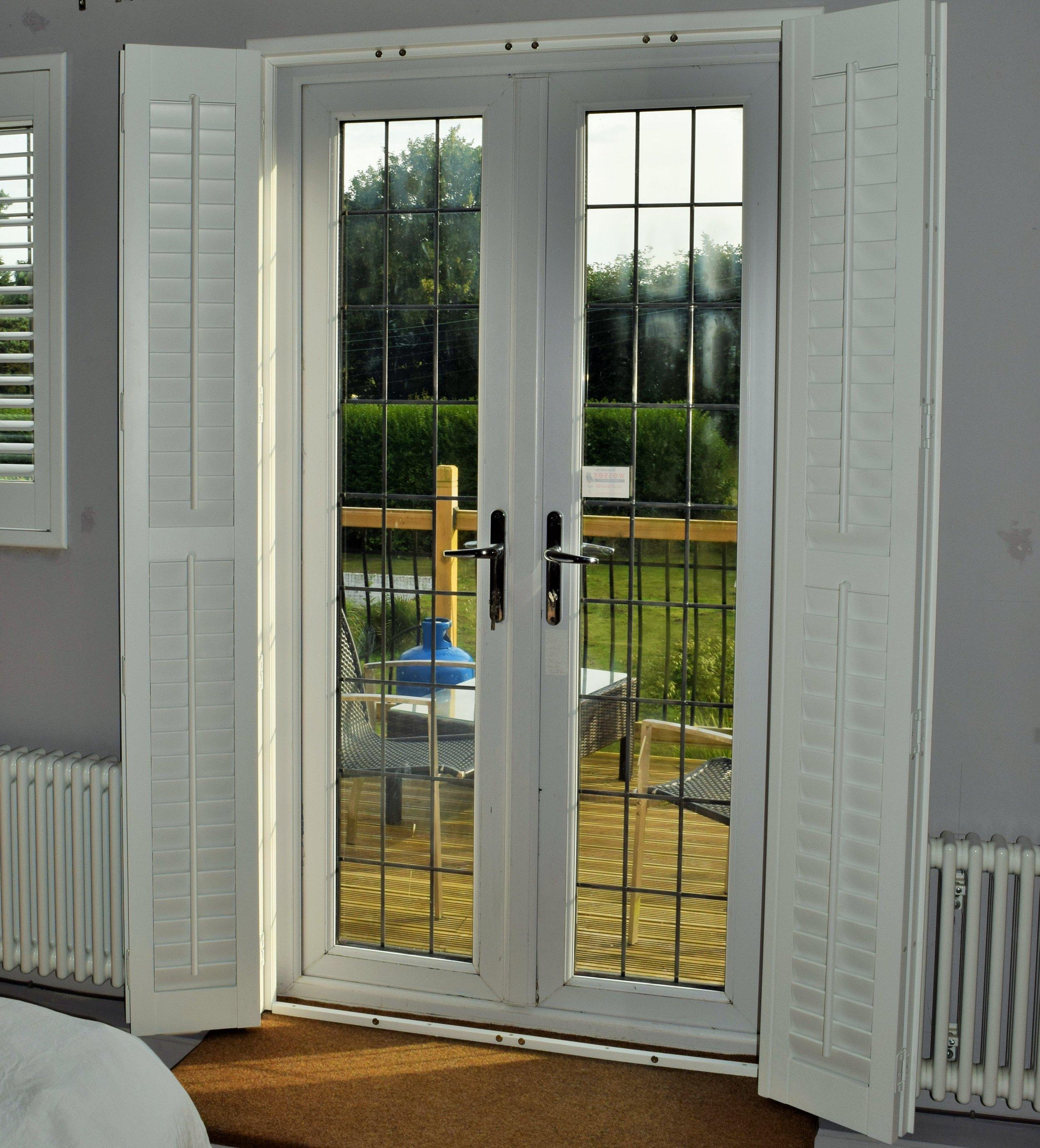 Patio door plantation shutters
