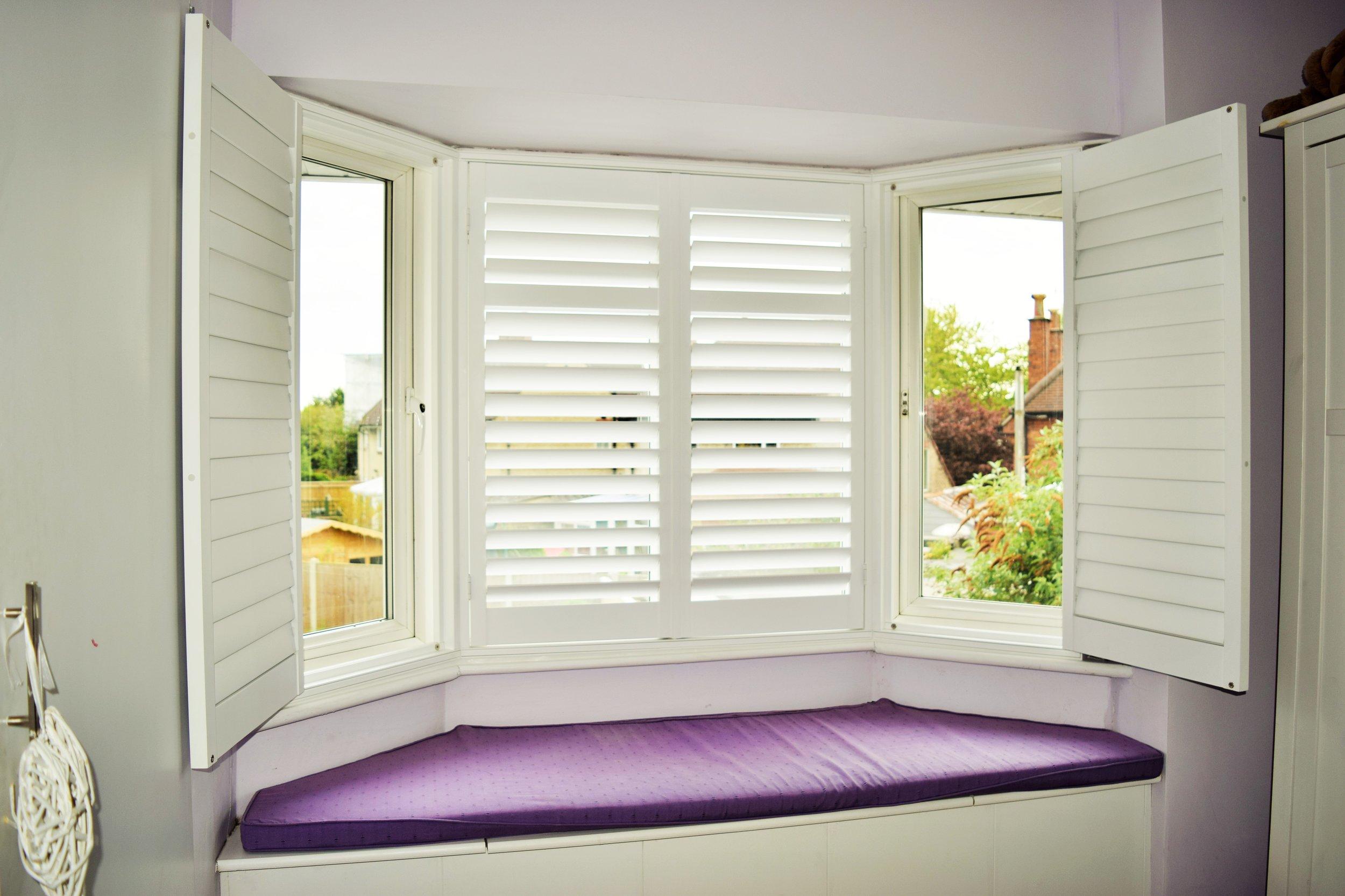 Bay window shutters with window seat