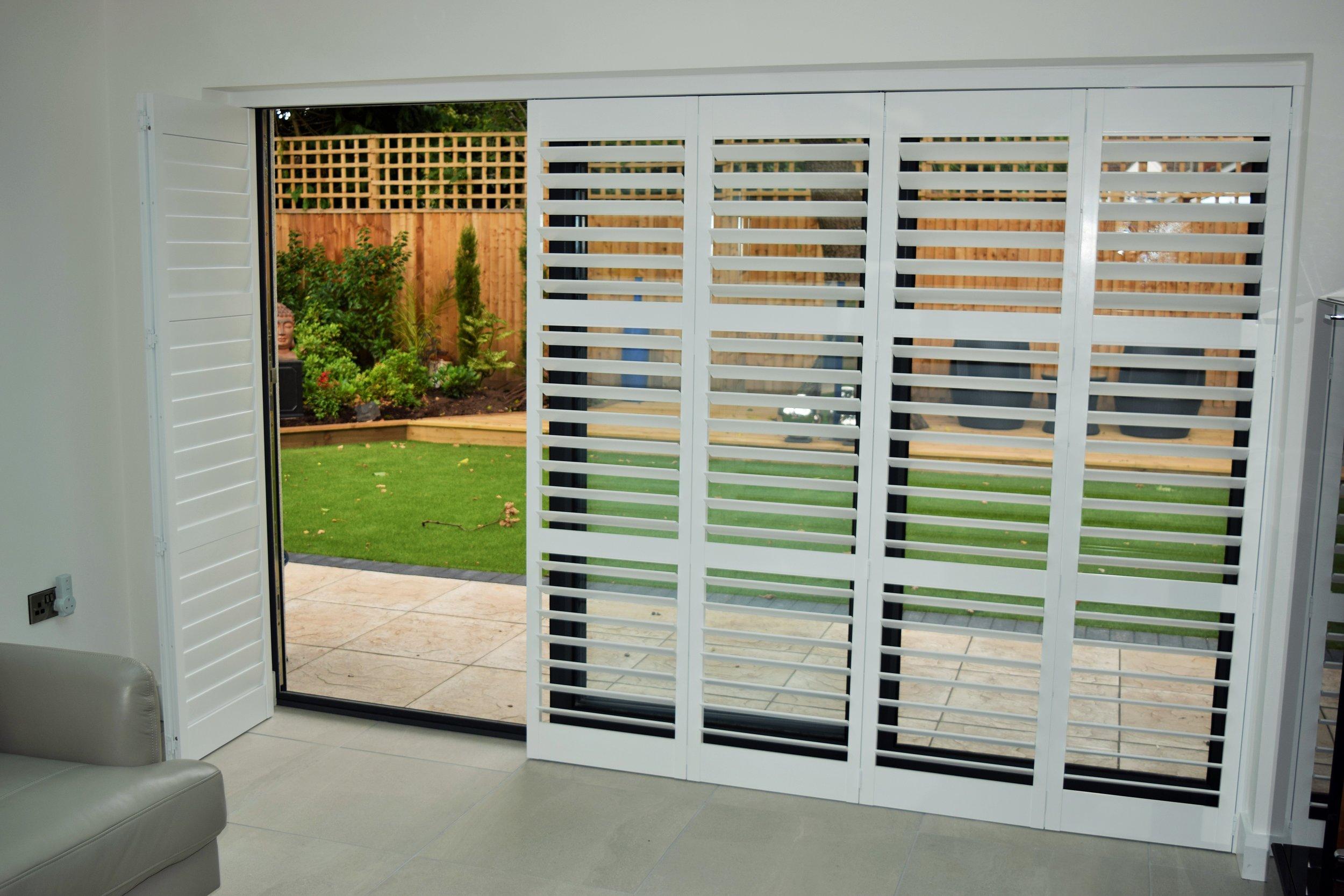 Tracked patio door shutters Verwood