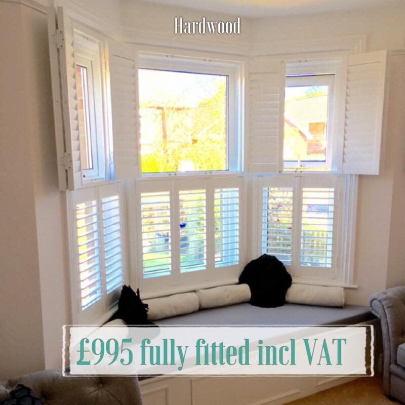 Tier and tier bay window shutters New Forest Lymington.jpg