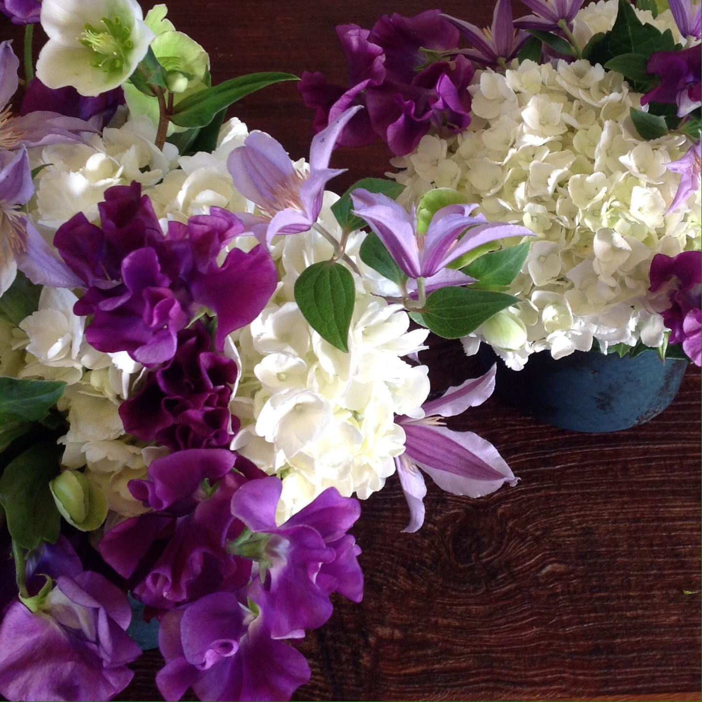Purple Sweet peas and Clematis with white roses