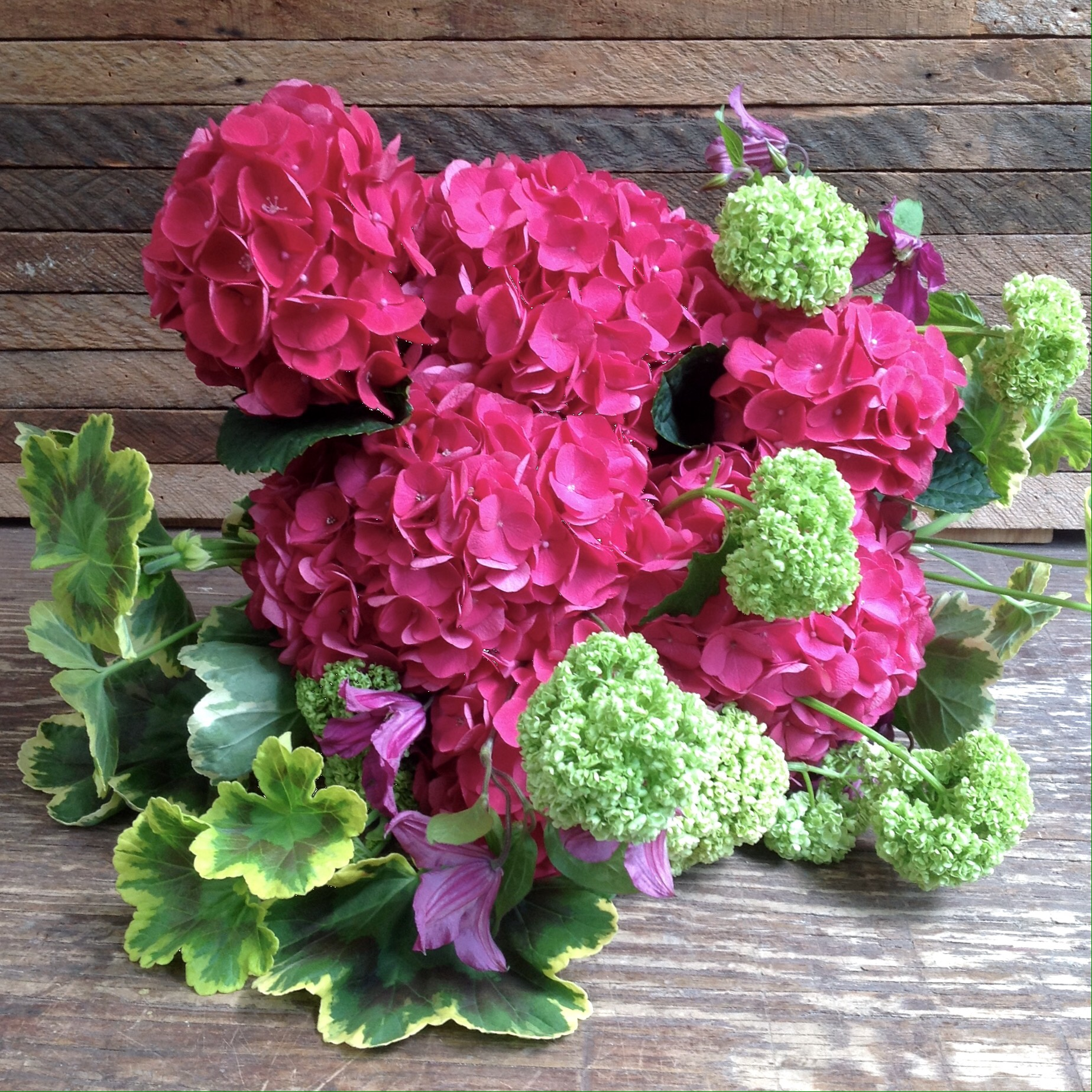 Pink Hydrangea wrapped bouquet starting at $135