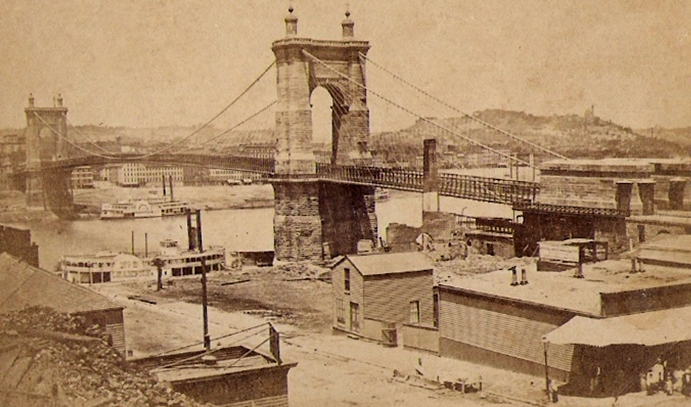 Suspension Bridge over the Ohio River, between Cincinnati, Ohio and Covington, Kentucky, circa 1870. Image source:  RoeblingBridge1870.jpg . Licensed under  Public Domain Mark 1.0 .