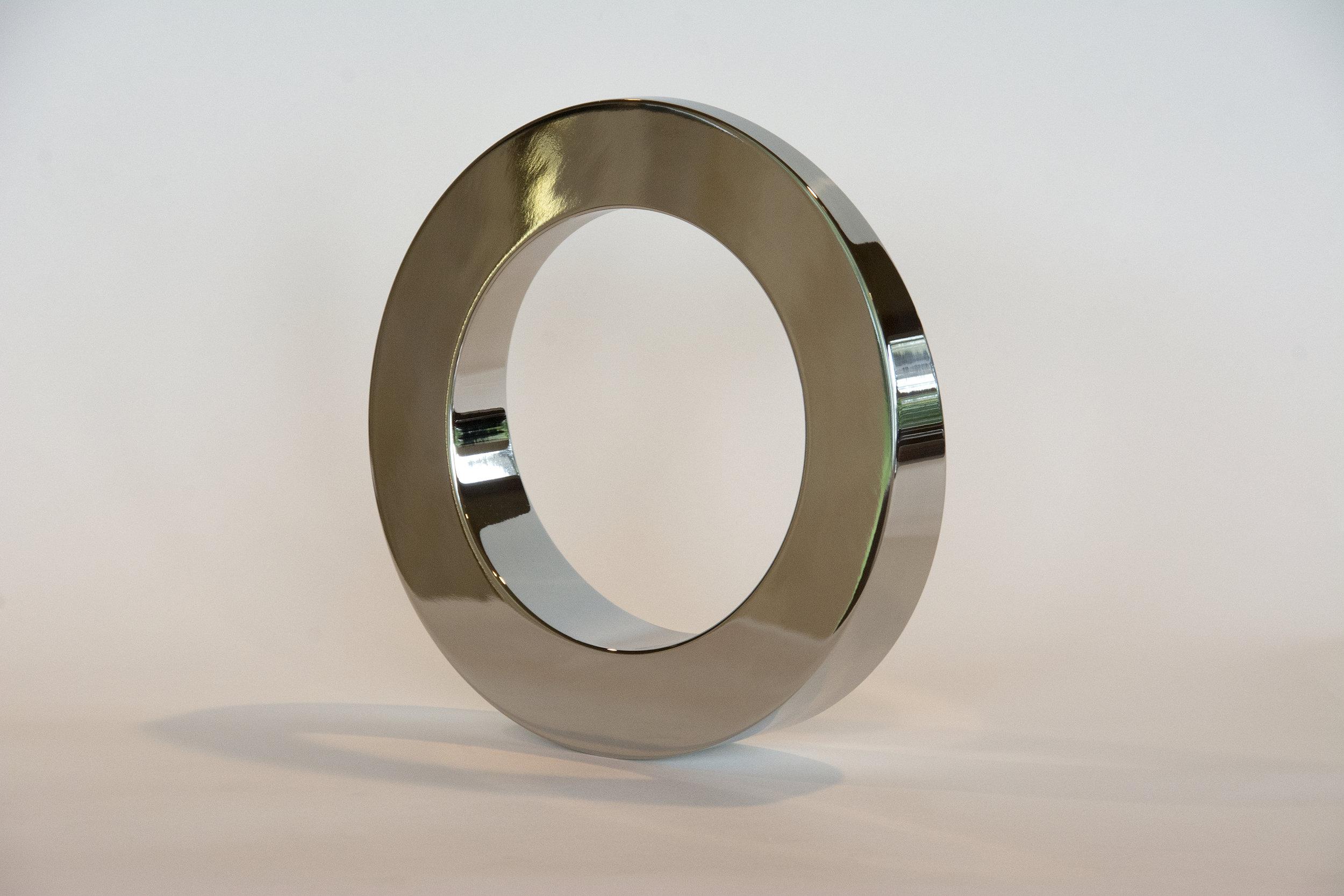 Stainless steel kinetic circle sculpture Tarik Currimbhoy