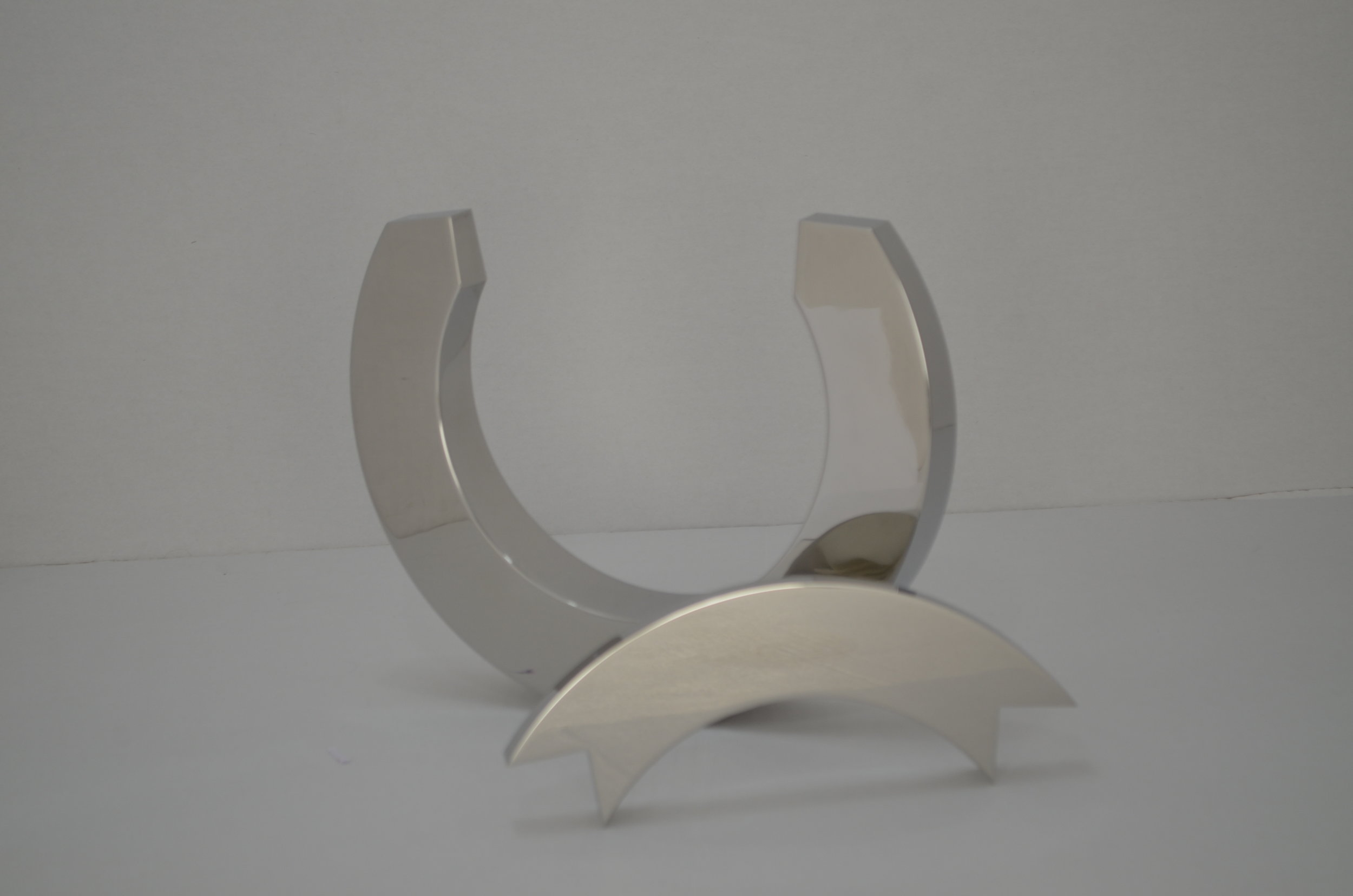 Kinetic steel sculpture in two pieces
