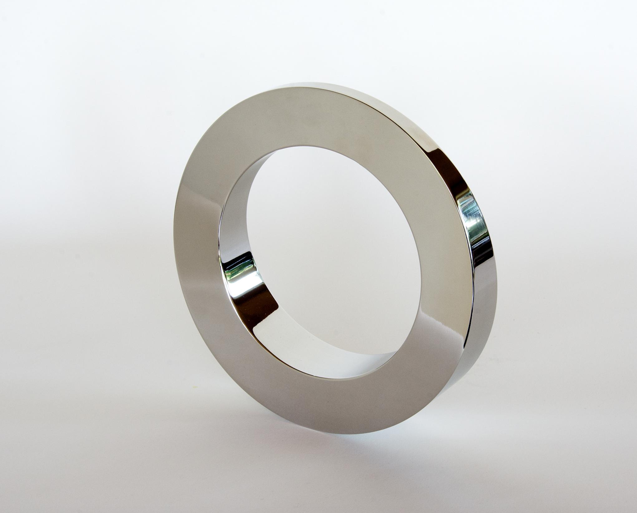 stainless steel, kinetic sculpture called rocker by tarik currimbhoy