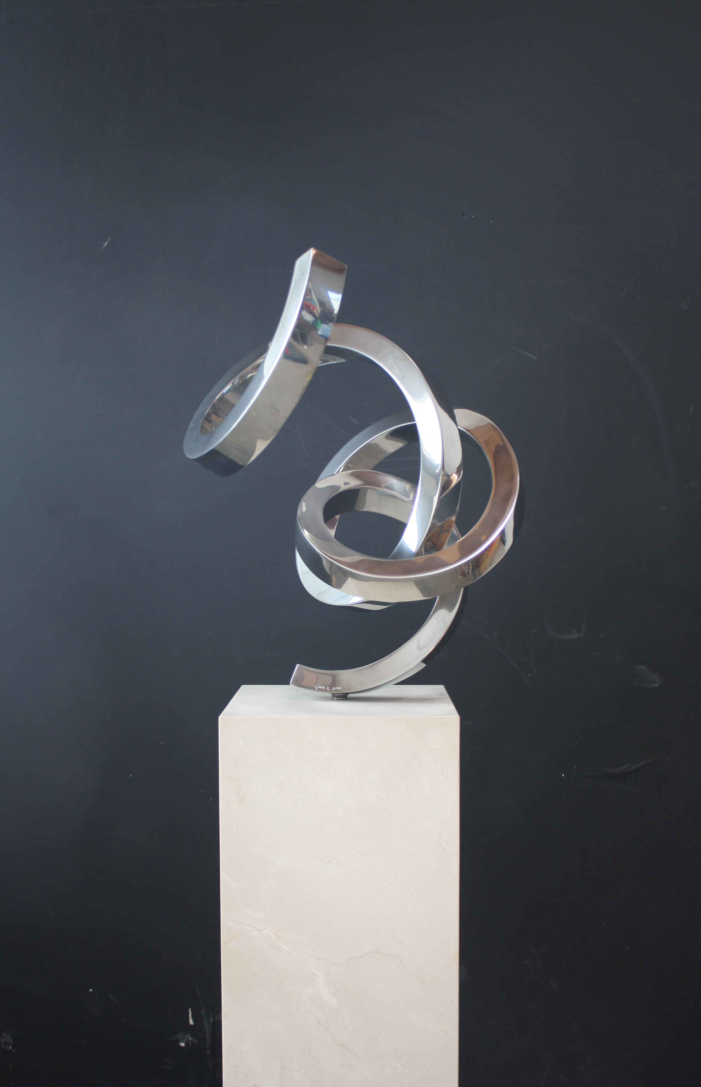 marine grade stainless steel sculpture gino miles titled Celebration