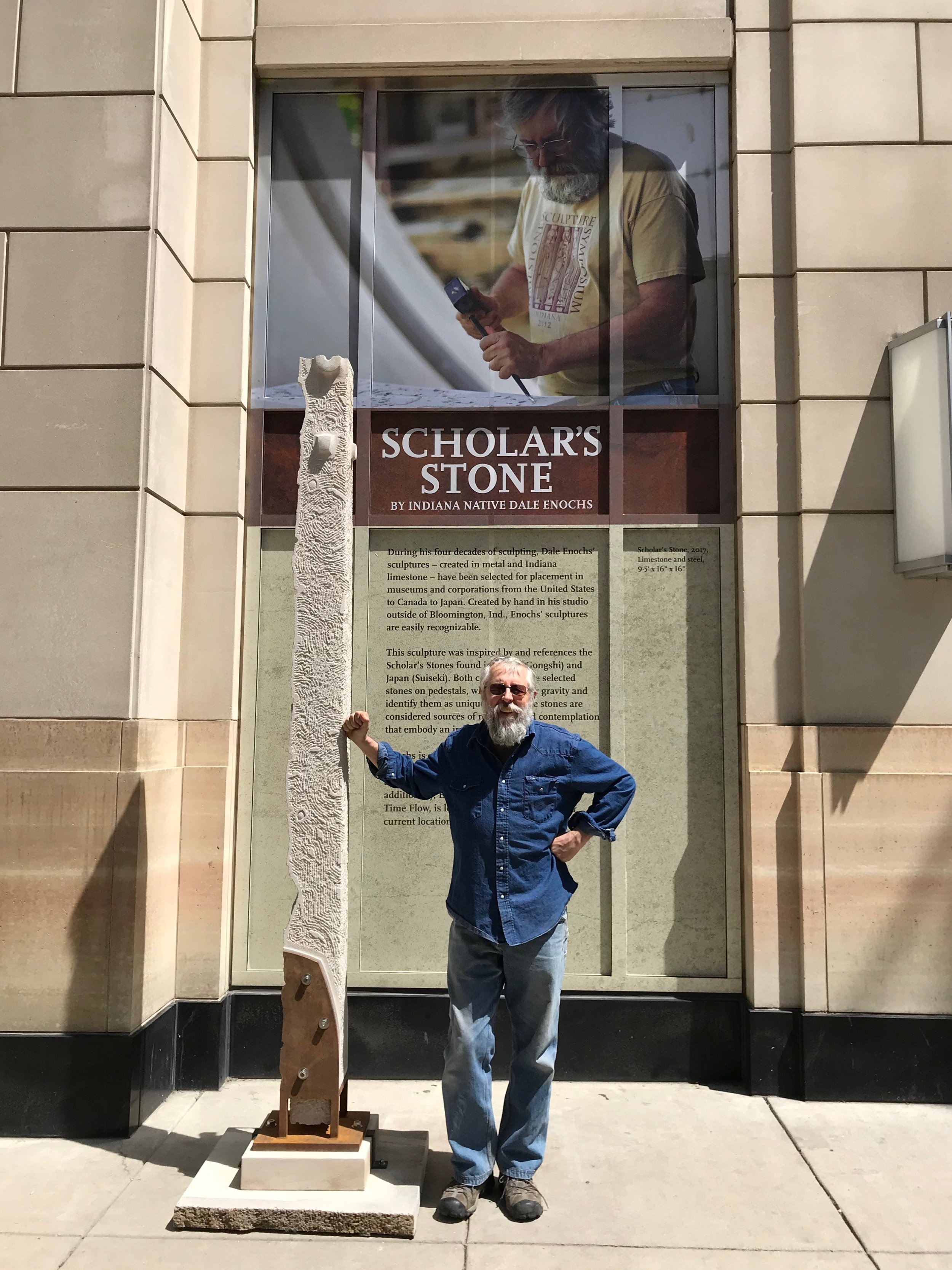 photo of scholar stone sculpture in front of conrad indianapolis with dale enochs