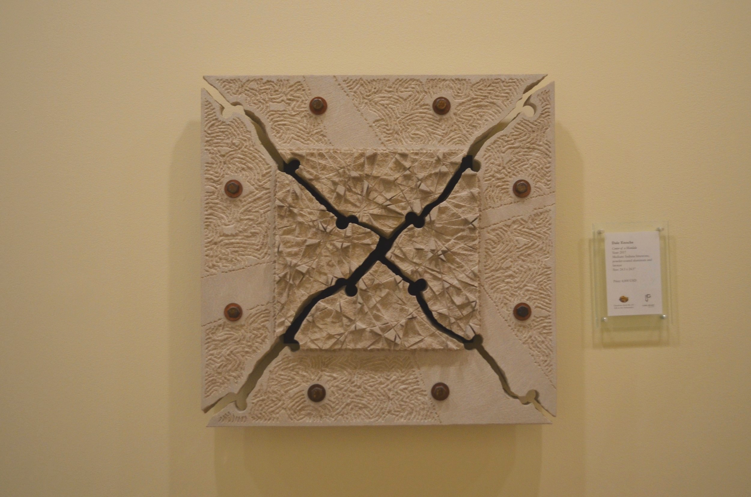 limestone wall sculpture called Canter of Mandala by Dale Enochs