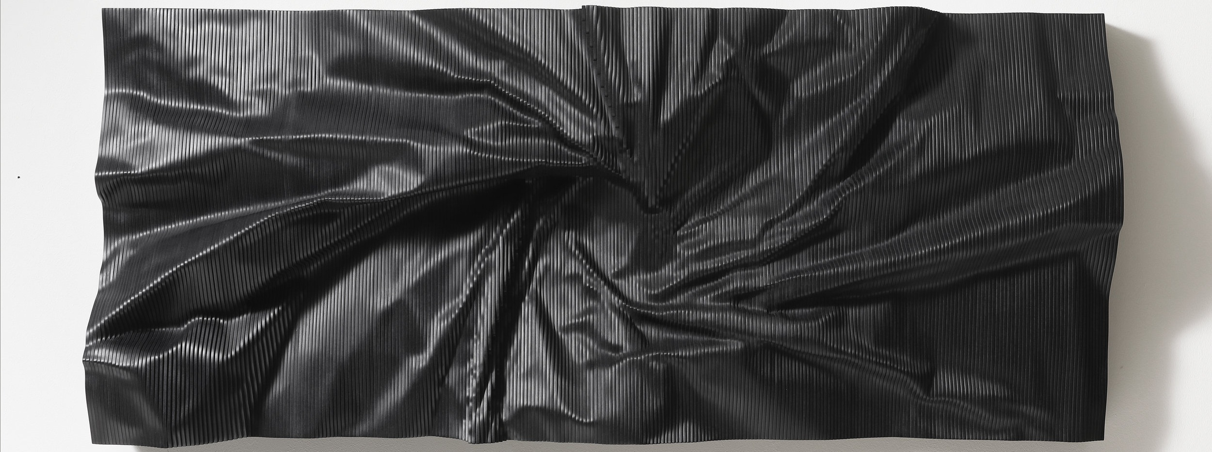 wall hanging sculpture made from engineered wood, black by cha jong rye